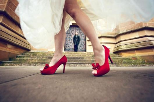 beautiful red wedding shoes for photo shoot